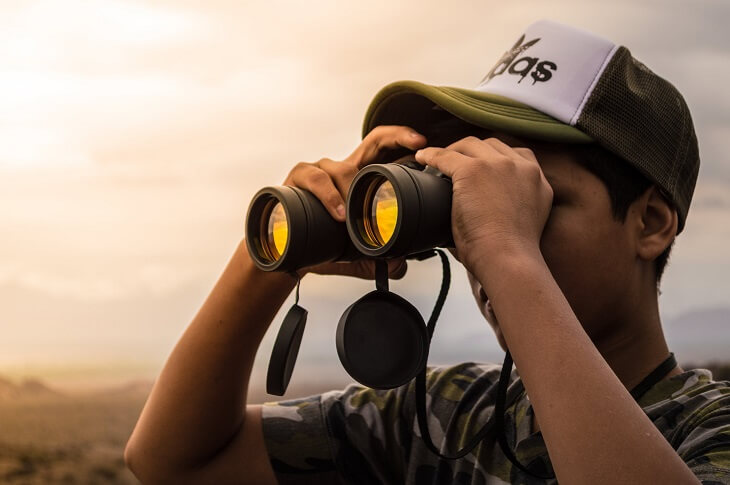Man looking in binoculars